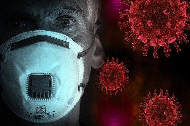 背景がウイルス。マスクをした人